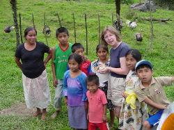 Carol with the youth at the base of the hill.